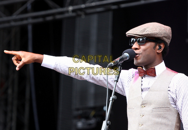 Aloe Blacc.Performing live at V festival, Chelmsford, Essex, England, UK, August 20th 2011..music concert gig live on stage half length  red bow tie sunglasses cap hat waistcoat white shirt microphone singing arm finger .CAP/ROS.©Steve Ross/Capital Pictures.