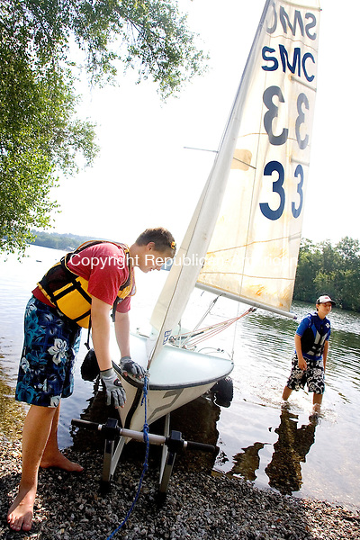 MIDDLEBURY, CT. 04 July 2012-070412SV06-From left, Ian Ray, 15, of Woodbury and Harold Smith, 14, of Middlebury get ready to launch their sail boat at the Quassapaug Sailing Center in Middlebury Wednesday..Steven Valenti Republican-American