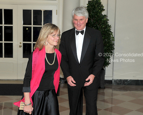Washington, D.C. - November 24, 2009 --  Assistant to the President and Counsel to the President Greg Craig and his wife, Margaret, arrive for the State Dinner in honor of  Dr. Manmohan Singh, Prime Minister of India at the White House in Washington, D.C. on Tuesday, November 24, 2009..Credit: Ron Sachs / CNP.(RESTRICTION: NO New York or New Jersey Newspapers or newspapers within a 75 mile radius of New York City)
