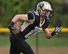 Wantagh No. 11 Dylan Beckwith returns a kick during the first quarter of a Nassau County Conference II varsity fiootball game against Garden City at Wantagh High School on Saturday, October 24, 2015. Garden City won by a score of 28-18.<br /> <br /> James Escher