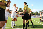 27 September 2009: Referee Tony Crush shakes hand with UNC captain Ali Hawkins (76). The University of North Carolina Tar Heels defeated the Wake Forest University Demon Deacons 4-0 at Fetzer Field in Chapel Hill, North Carolina in an NCAA Division I Women's college soccer game.