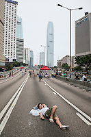 Hong Kong, Government Offices, 2 October 2014<br /> <br /> Students and other supporters of the Occupy Central movement congregating around the government offices area at Tamar. All the roads in the area are blocked from traffic and public transport.<br /> Many students and activists spent a fourth night sleeping on the street<br /> <br /> Photo Kees Metselaar