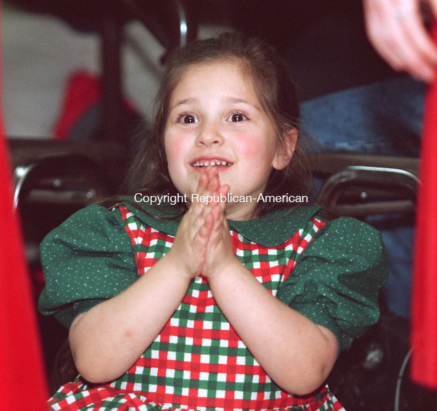"""MIDDLEBURY, CT 12/20/98 --1220JH08.tif--Megan Devine, 6, of Bethlehem watched with delight as some of the other   children danced  during the Horgan Academy of Irish Dance's 7th annual """"Chirtsmas in Killarney"""" Ceili Sunday at the Shepardson Community Center in Middlebury. About 100 attended, mostly children who attend the academy and their families.  JOHN HARVEY staff photo for Lambert story."""
