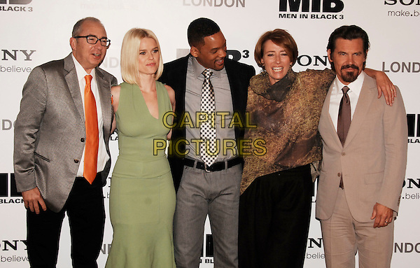 Barry Sonnenfeld, Alice Eve, Will Smith, Emma Thompson, Josh Brolin.The UK photocall for 'Men In Black 3' at the Dorchester Hotel, Park Lane, London, England..16th May 2012.half length grey gray suit jacket orange tie white shirt glasses green dress brown print top beige goatee facial hair MIB3 III.CAP/WIZ.© Wizard/Capital Pictures.