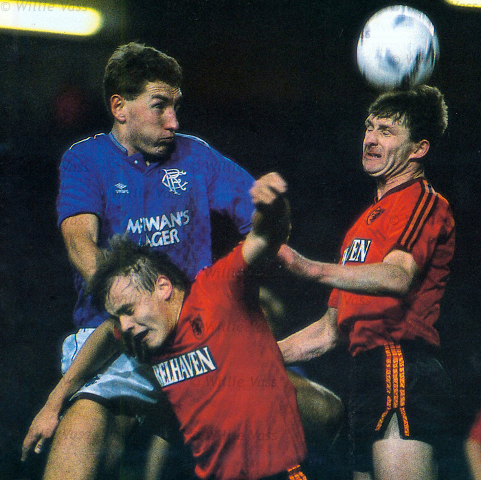 Terry Butcher wins a header and beats Mixu Paatelainen and Paul Hegarty
