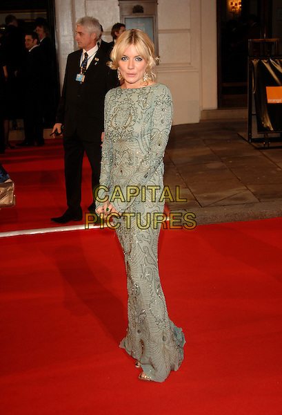 SIENNA MILLER.Red Carpet Arrivals at The Orange British Academy Film Awards (BAFTA's) held at the Royal Opera House, Covent Garden, London, England, February 11th 2007..full length grey silver gold beaded long sleeved dress.CAP/PL.©Phil Loftus/Capital Pictures