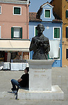 Taking it easy, leaning against monument of famous Venetian opera composer Baldassare Galuppi, in Burano Venice lagoon, Italy, May 2007.