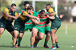 Willy Mata'afa Brown rumbles his way through the Pukekohe defenders, Ian West-Stevens and Vuniani Bainitabua. Counties Manukau Premier Club rugby game between Pukekohe and Waiuku, played at Colin Lawrie Fields, Pukekohe on Saturday April 14th, 2018. Pukekohe won the game 35 - 19 after leading 9 - 7 at halftime.<br /> Pukekohe Mitre 10 Mega -Joshua Baverstock, Sione Fifita 3 tries, Cody White 3 conversions, Cody White 3 penalties.<br /> Waiuku Brian James Contracting - Lemeki Tulele, Nathan Millar, Tevta Halafihi tries,  Christian Walker 2 conversions.<br /> Photo by Richard Spranger