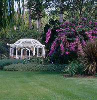 A pagoda-style pavillion is located at the end of the manicured garden