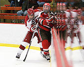 Danny Biega (Harvard - 9), Nick Pitsikoulis (St. Lawrence - 22) - The Harvard University Crimson defeated the St. Lawrence University Saints 4-3 on senior night Saturday, February 26, 2011, at Bright Hockey Center in Cambridge, Massachusetts.