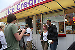 Zack Conroy takes photo of Lawrence Saint-Victor and fan - Guiding Light's actors meet fans at Stacy Jo's Ice Cream in McKees Rocks, PA on September 30, 2009. During the weekend of events proceeds from pink ribbon bagel sales at various Panera Bread locations will benefit the Young Women's Breast Cancer Awareness Foundation. (Photo by Sue Coflin/Max Photos)