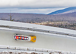9 January 2016: Swiss pilot Rico Peter leads his 4-man team as they cruise through Curve 14 during their second run of the day at the BMW IBSF World Cup Bobsled Championships at the Olympic Sports Track in Lake Placid, New York, USA. Peter's team came in 5th for the day, with a 2-run combined time of 1:50.13. Mandatory Credit: Ed Wolfstein Photo *** RAW (NEF) Image File Available ***
