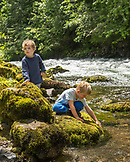 USA, Oregon, Santiam River, Brown Cannon, young boys playing in the Willamete National Forest near the Santiam River