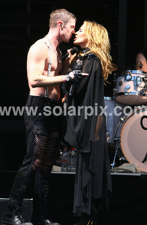 **ALL ROUND PICTURES FROM SOLARPIX.COM**.**WORLDWIDE SYNDICATION RIGHTS**.Kylie Minogue performs live with the Scissor Sisters at Glastonbury Festival of Contemporary Performing Arts on Saturday 26 June 2010 in Glasonbury, England..JOB REF:11563      LNJ     DATE:26.06.2010.**MUST CREDIT SOLARPIX.COM OR DOUBLE FEE WILL BE CHARGED**.**MUST NOTIFY SOLARPIX OF ONLINE USAGE**.**CALL US ON: +34 952 811 768 or LOW RATE FROM UK 0844 617 7637**