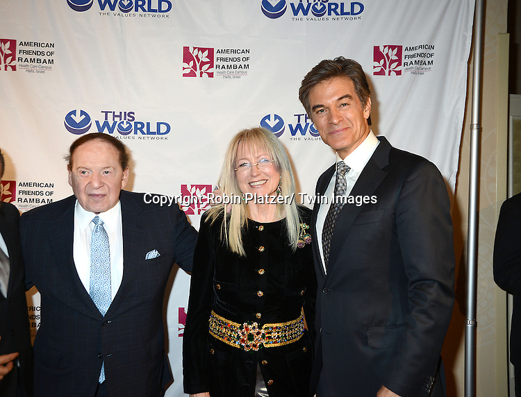 Sheldon Adelson, Dr Miriam Adelson and Dr Mehmet Oz attend the Inaugural Champion of Jewish Values International Awards Gala on June 4, 2013 at the Marriott Marquis Hotel in New York City. Sheldon Adelson, Mrs Miriam Adelson and Dr Mehmet Oz were honored.