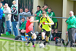 Killarney Celtic's David O'Sullivan gets by St Brendans Park's David Rogers in the premier league final at Mounthawk Park, Tralee on Sunday.