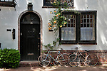 A townhouse in downtown Philadelphia with bikes in front of the door
