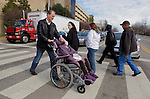 William Massart, left, walks his daughter Sandra Massart, 10, across the street toward Duke University Hospital in Durham, NC, USA, on Tuesday, Feb. 14, 2012.  Sandra Massart is being treated for MLD, a degenerative condition.  Photo by Ted Richardson