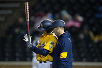 Kent State Golden Flashes third base coach Alex Marconi (right) gives instructions to John Matthews (10) during the game against the Wake Forest Demon Deacons in game two of a double-header at David F. Couch Ballpark on March 4, 2017 in  Winston-Salem, North Carolina.  The Demon Deacons defeated the Golden Flashes 5-0.  (Brian Westerholt/Four Seam Images)