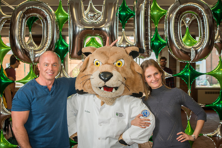 Photographs of OUHCOM staff, faculty, and students with Rufus the Bobcat wearing a white coat with the Homecoming decorations in Irvine Hall on the Ohio University campus in Athens, Ohio on Oct. 6, 2015. [Photograph by Joel Prince]