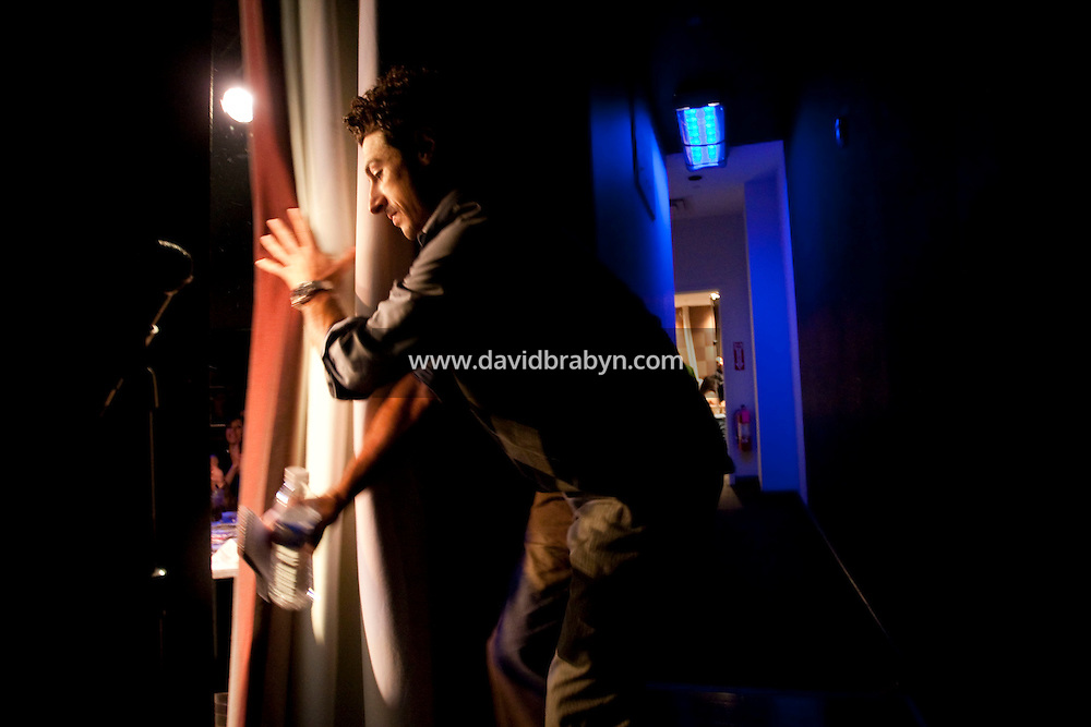 Comedian Aron Kader enters the stage during the 6th Annual NY Arab-American Comedy Festival in New York, USA, 13 May 2009.
