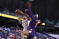GREENSBORO, NC - MARCH 6: Taylor Soule #13 of Boston College shoots over Nique Cherry #35 of Clemson University during a game between Clemson and Boston College at Greensboro Coliseum on March 6, 2020 in Greensboro, North Carolina.