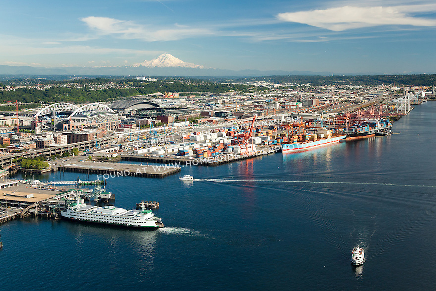 Seattle waterfront with a Washington State ferry at Coleman Dock, Port of Seattle, and Mount Rainier behind; Seattle, WA