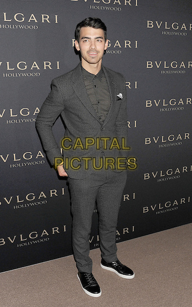 WEST HOLLYWOOD, CA- FEBRUARY 25: Musician Joe Jonas arrives at the BVLGARI 'Decades Of Glamour' Oscar Party Hosted By Naomi Watts at Soho House on February 25, 2014 in West Hollywood, California.<br /> CAP/ROT/TM<br /> &copy;Tony Michaels/Roth Stock/Capital Pictures