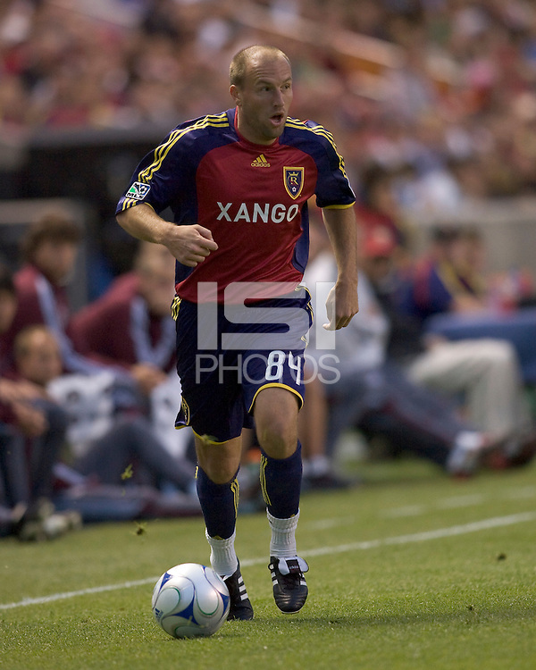 Real Salt Lake midfielder Clint Mathis (84) dribbles down wing. Real Salt Lake tied the Colorado Rockies, 1-1, at Rio Tinto Stadium on June 6, 2009.