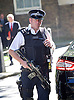 Cabinet meeting arrivals <br /> Downing Street, London, Great Britain <br /> 19th July 2016 <br /> <br /> New members of the Cabinet <br /> arriving ahead of the first cabinet meeting chaired by Theresa May <br /> <br /> armed Police officer patrols Downing Street <br /> <br /> <br /> Photograph by Elliott Franks <br /> Image licensed to Elliott Franks Photography Services