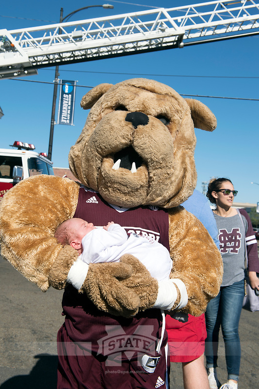 Bully holding a baby<br />  (photo by Beth Wynn / &copy; Mississippi State University)