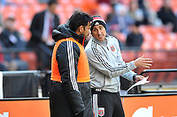 Carlos Ruiz (20) of D.C. United is given the last instructions from assistant coach Josh Wolff before entering the game. The Columbus Crew defeated D.C. United 2-1 ,at RFK Stadium, Saturday March 23,2013.