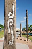 Indigenous totem poles on the Victoria Parade foreshore.  Thursday Island, Torres Strait Islands, Queensland, Australia
