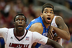Center Karl-Anthony Towns of the Kentucky Wildcats fights for a rebound during the game against  the Louisville Cardinals at KFC Yum! Center on Saturday, December 27, 2014 in Louisville `, Ky. Kentucky defeated Louisville 58-50. Photo by Michael Reaves | Staff