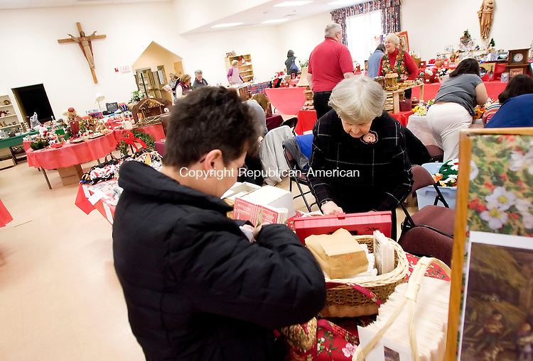 BETHLEHEM, CT- 18 NOV 2007- 111807JT10- <br /> Pat Preston, left, of Roxbury buys Lauren Ford Christmas cards from Barbara Ensign on Saturday, Nov. 17 during a holiday bazaar at the Church of the Nativity in Bethlehem. <br /> Josalee Thrift / Republican-American