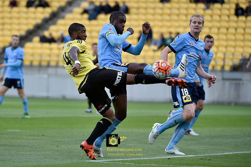 Wellington Phoenix&rsquo; Roy Krishna and Sydney Jacques Faty in action during the A League - Wellington Phoenix v Sydney FC at Westpac Stadium, Wellington, New Zealand on Saturday 19 December 2015.<br /> Photo by Masanori Udagawa. <br /> www.photowellington.photoshelter.com.