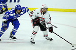 SIOUX FALLS, SD - MARCH 23: Mikey Eyssimont #19 from St. Cloud State University makes a rush on net in front of Jonathan Kopacka #52 from Air Force during their game at the 2018 West Region Men's NCAA DI Hockey Tournament at the Denny Sanford Premier Center in Sioux Falls, SD. (Photo by Dave Eggen/Inertia)