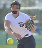 Abigail Canelle #17, Smithtown West pitcher, delivers to the plate in the top of the fourth inning of a Suffolk League IV varsity softball game against rival Smithtown East at Smithtown High School West on Wednesday, May 2, 2018. She pitched a complete game in West's 7-1 win.