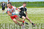 An Ghaeltacht Aodan Mac Gearailt in possession of the ball closely watched by Ardfert John Egan during the CSFL Div. 3 match at Gallarus on Sunday afternoon.