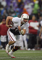 Oct 30, 20010:  Stanford quarterback #12 Andrew Luck breaks up field for a first down against Washington.  Stanford defeated Washington 41-0 at Husky Stadium in Seattle, Washington...