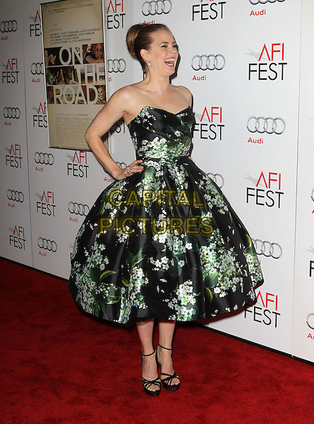 Amy Adams.AFI FEST 2012 'On The Road' gala screening, Grauman's Chinese Theatre, Hollywood, California, USA..3rd November 2012.full length dress  black strapless green floral print ankle strap shoes hands on hips side profile mouth open laughing smiling funny .CAP/ADM/KB.©Kevan Brooks/AdMedia/Capital Pictures.