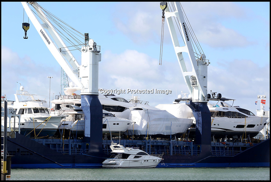 BNPS.co.uk (01202 558833)<br /> Pic: CorinMesser/BNPS<br /> <br /> ****Please use full byline****<br /> <br /> A precious cargo of luxury motorboats worth £25 million are loaded onto an enormous cargo ship for a piggy-back ride to their new wealthy Mediterranean owners.<br /> <br /> Seven plush powerboats made by Sunseeker carefully craned onto a special 300ft transporter ship at the company's boatyard in Poole, Dorset.<br /> <br /> The boats are destined for a number of undisclosed millionaire's resorts around the Mediterranean.<br /> <br /> Included in the shipment were two Sunseeker 28 Metre Yachts each worth £6 million plus one Predator 115 which sells for £11 million.<br /> <br /> It comes weeks after the firm unveiled the biggest boat ever built in the UK - a whopping 155ft superyacht made for Formula One mogul Eddie Jordan for an estimated £32 million.