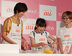"March 2, 2017, Tokyo, Japan - Japanese actress Marina Watanabe (L) and Rio Suzuki bake a roll-cake using a cooking app of the new smart phone ""rafre"", produced by Kyocera in Tokyo on Thursday, March 2, 2017. The new handset features a hand gesture sensor which enablees to scroll display without touching screen.    (Photo by Yoshio Tsunoda/AFLO) LwX -ytd-"