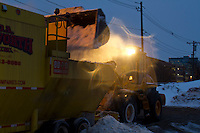 A Night at the Snow Farm<br /> A loader dumps snow into a snow melting machine at Boston's largest snow farm, South Boston, MA.