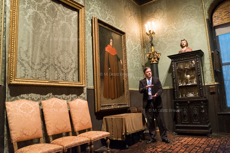 "Anthony Amore is the Directory of Security and Chief Investigator at the Isabella Stewart Gardner Museum in Boston, Mass., USA, seen here in The Dutch Room at the museum on Tues., Dec. 5, 2017. Part of Amore's ongoing work is the investigation into the 1990 theft of 13 pieces from the museum: 10 paintings, 2 objects, and 1 etching. Among the paintings stolen were works by Rembrandt, Vermeer, Degas, and Manet. The large empty frame on the wall is what held Rembrandt's ""The Storm on the Sea of Galilee"" painting until it was stolen from the museum in the heist."