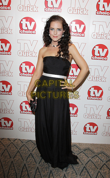 STEPHANIE WARING .TV Choice & TV Quick Awards at the Dorchester Hotel, Park Lane, London, England..September 7th 2009.full length strapless maxi dress hand on hip white ribbon waistband black strapless clutch bag  .CAP/ROS.©Steve Ross/Capital Pictures.