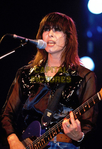 CHRISSIE HYNDE - THE PRETENDERS.Ref: 038.stage, concert, playing guitar, live, half length, half-length, singing.www.capitalpictures.com.sales@capitalpictures.com.© Capital Pictures