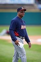 Toledo Mudhens coach Basilio Cabrera (30) walks to home plate for the lineup exchange before a game against the Rochester Red Wings on June 12, 2016 at Frontier Field in Rochester, New York.  Rochester defeated Toledo 9-7.  (Mike Janes/Four Seam Images)