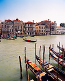 ITALY, Venice, gondolas on canal with buildings in the background