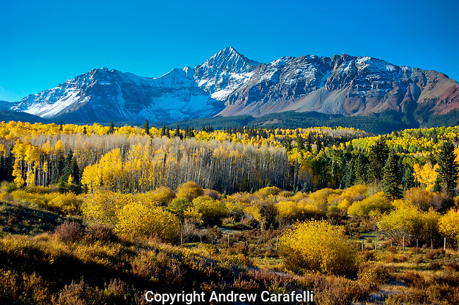 Changing aspens and a dusting of new early snow on 14,000 Wilson Peak near Telluride, Colorado show off the Rocky Mountains at their best.